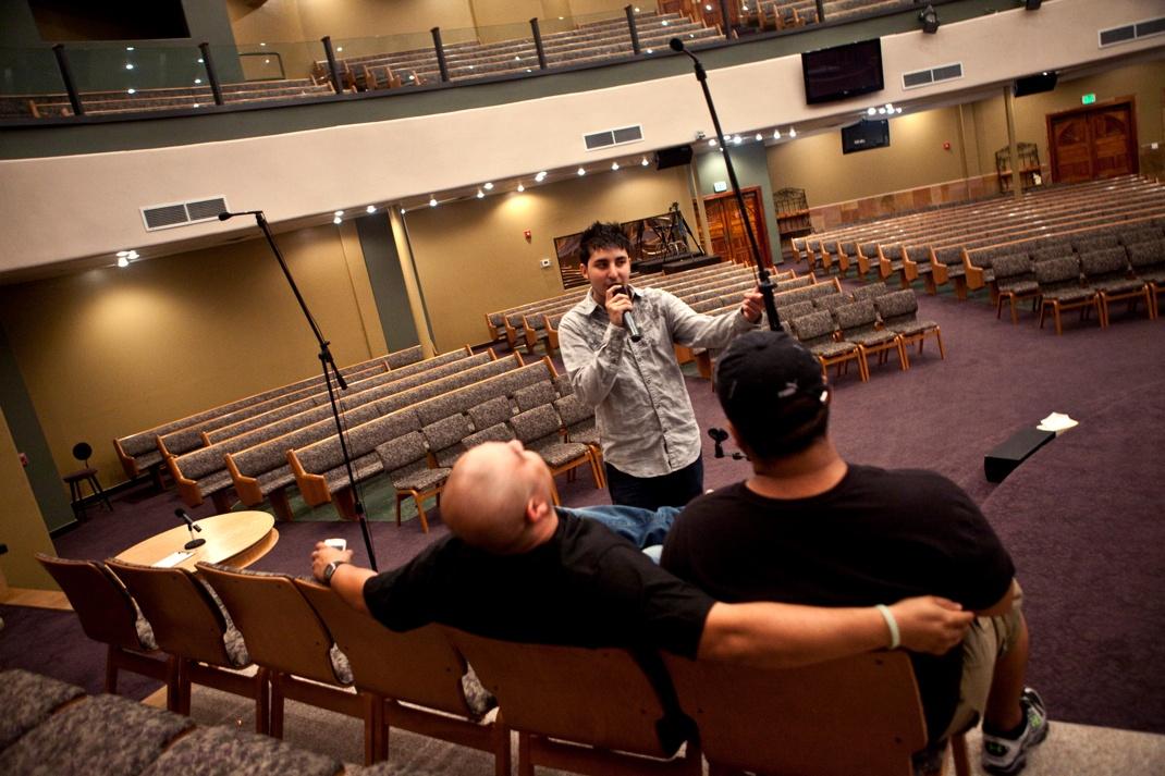 Church tech using wireless mic
